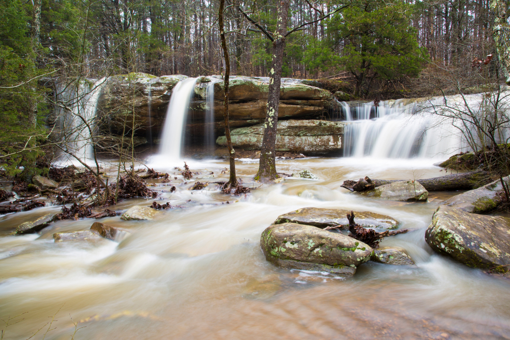 three waterfalls flowing over rocks into a rocky stream in an article about waterfalls in Illinois