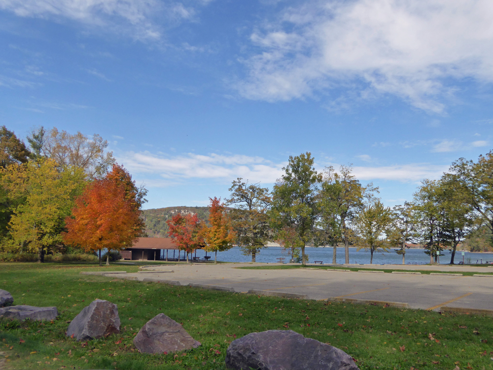 Trees in orange leaves of autumn around lake. Fall in Wisconsin.