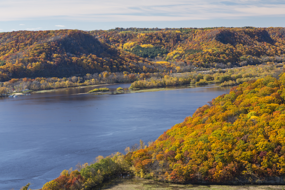A lake with mountains covered in fall foliage