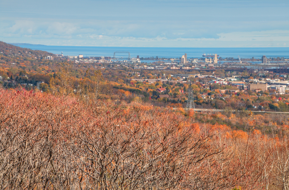 A view over Duluth town with foliage in the foreground in an article about things to do in Duluth