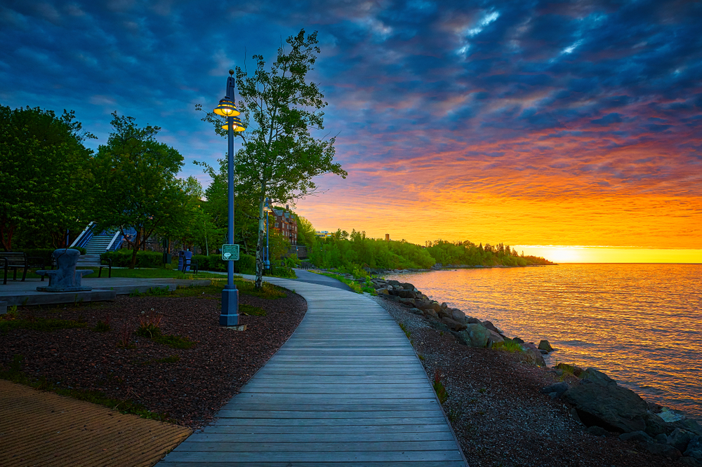 A park by a lake at sunrise Canal Park is one of the things to do in Duluth