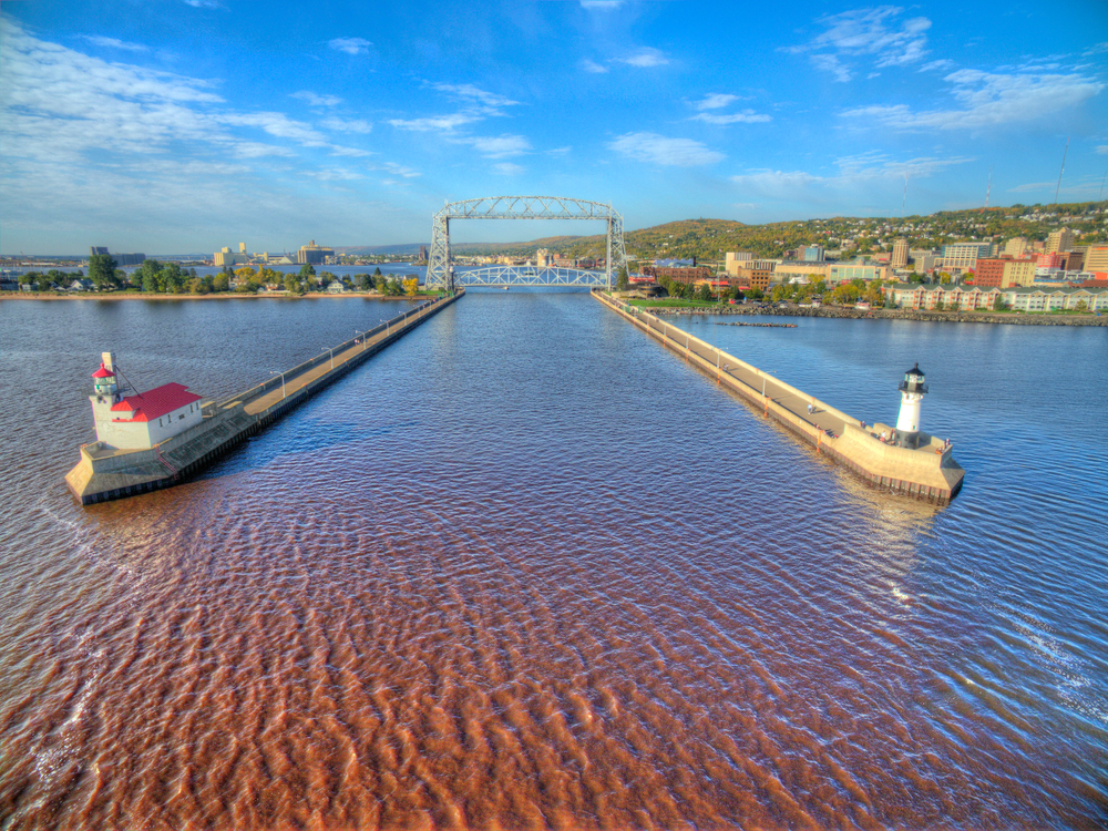Two lighthouses with the aerial bridge in the background. The lift tower is one of the things to do in Duluth