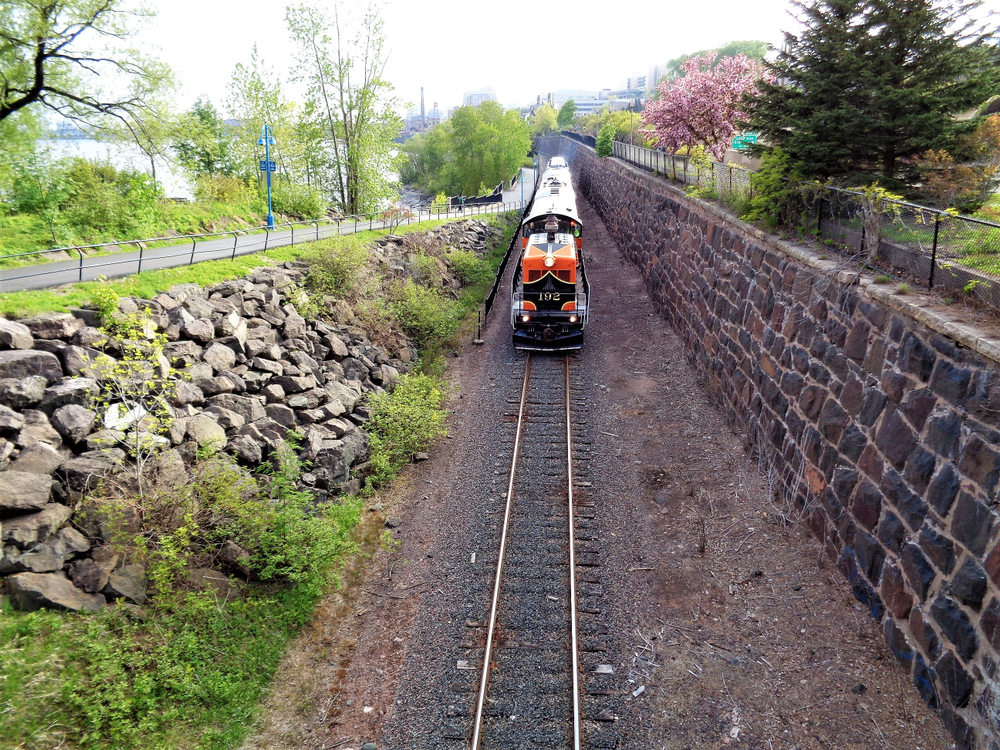 An old train on the track in a deep embankment