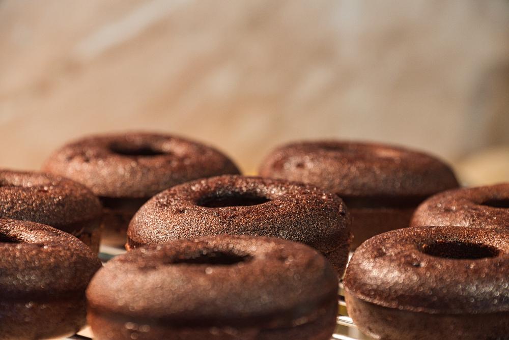Chocolate vegan doughnuts on a cooling rack