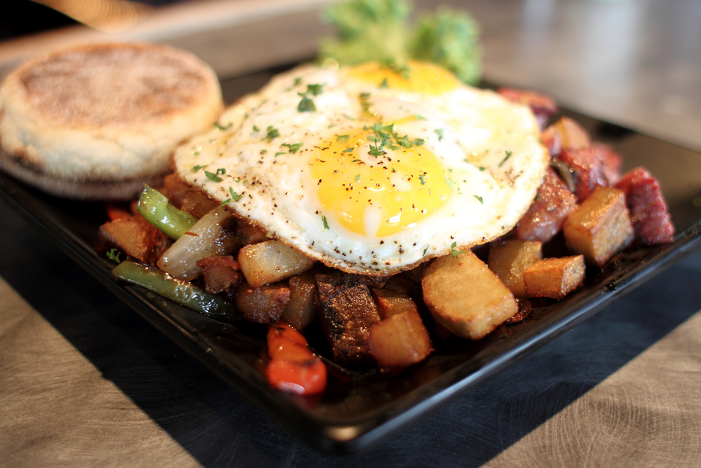 Corn Beef Hash on a plate with an english muffin. A famous Cleveland breakfast