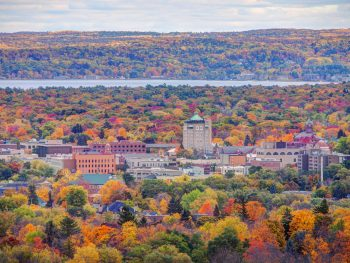 Aerial view of the skyline of Downtown Traverse City surrounded by fall foliage