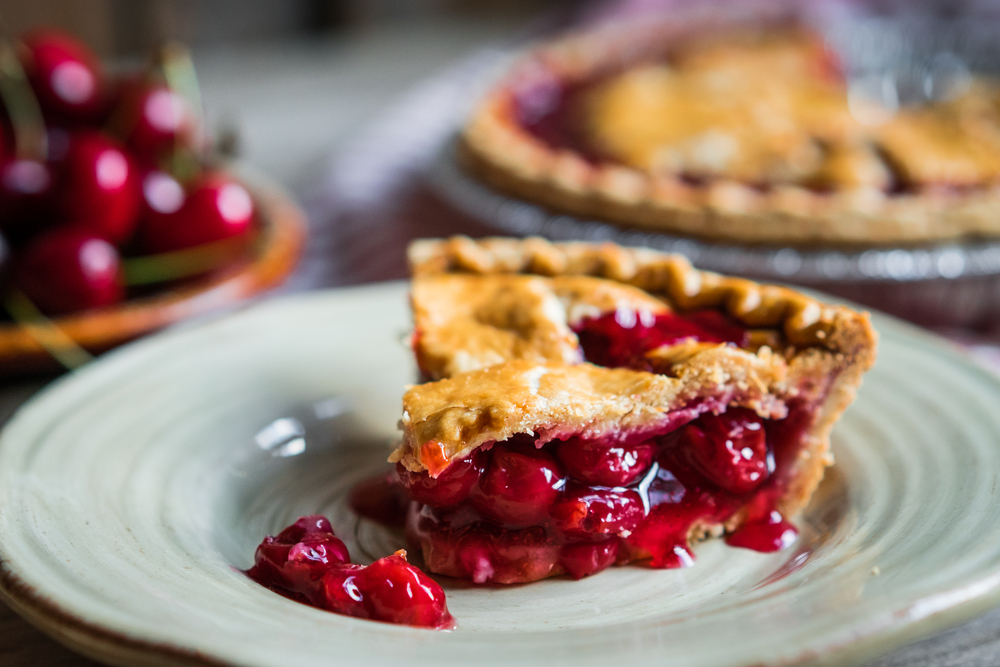 Homemade Cherry Pie On A white plate on a table