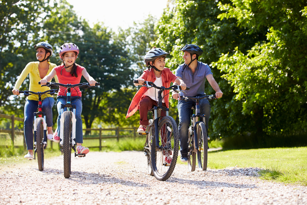 A family of four on a cycle ride in the countryside