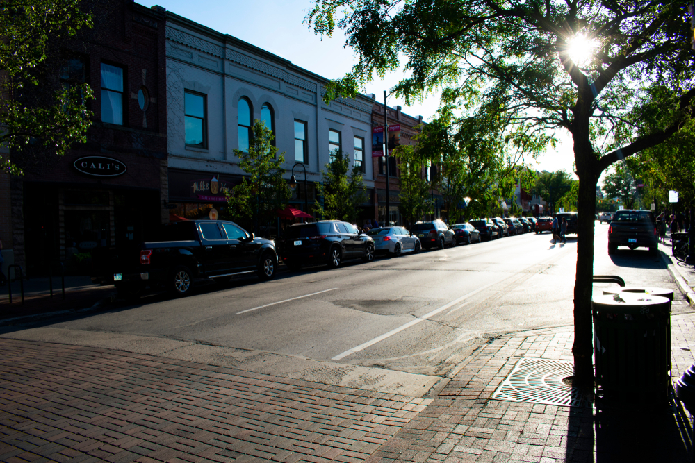 A street in a town with old buildings up one side. Front Street in Traverse City