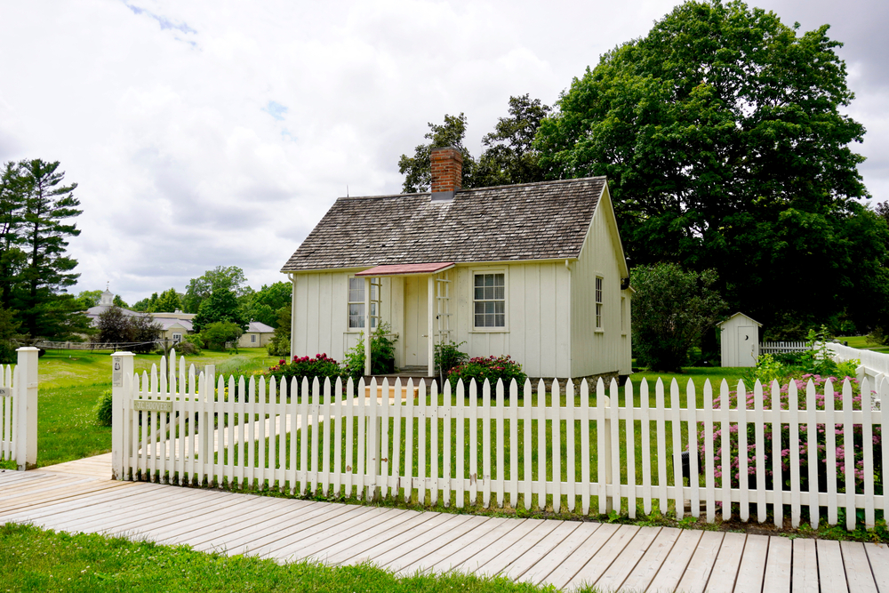 The little, white house and white, picket fence where Herbert Hoover lived as a child.