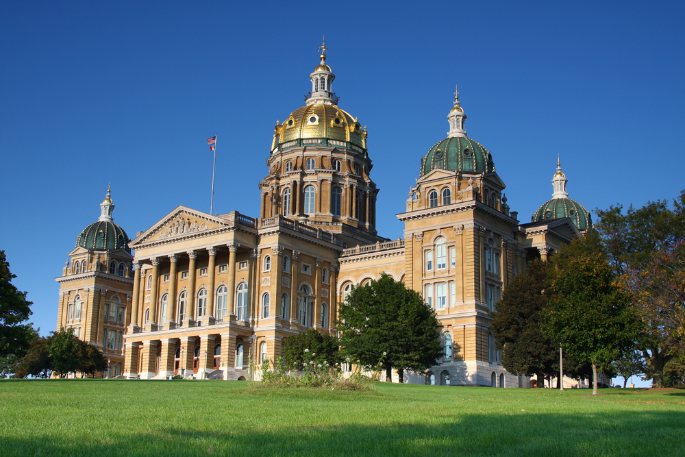 Large ornate capitol building with gold accents and domes. One of the interesting things to do in Iowa