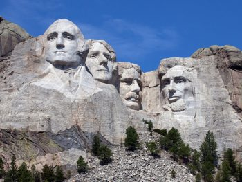 Heads of 4 presidents carved into rock of mountain. Things to do in South Dakota not to miss.