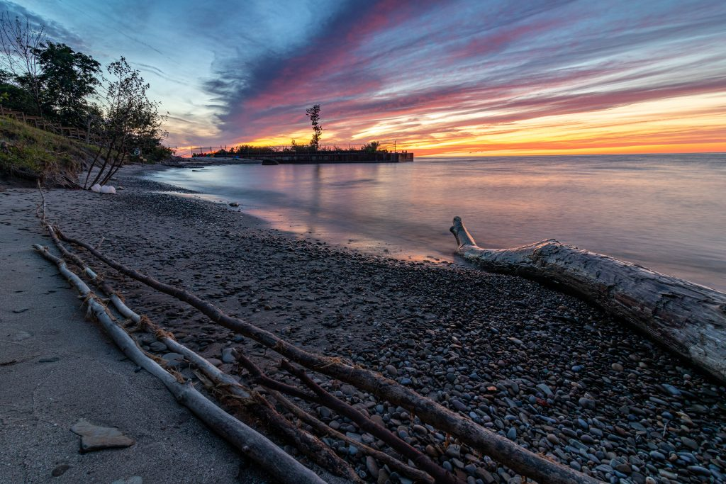 One of the most beautiful beaches in the small Ohio town of Ashtabula. With gorgeous sunset of oranges and yellows.