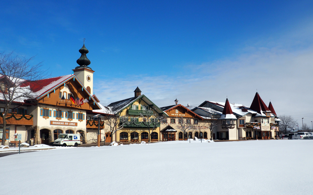 Cute Bavarian buildings in Frankenmuth, Michigan, covered in snow.
