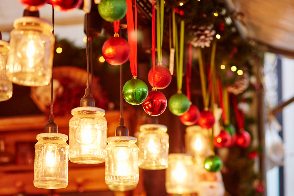 Christmas decorations hanging in a market stall.