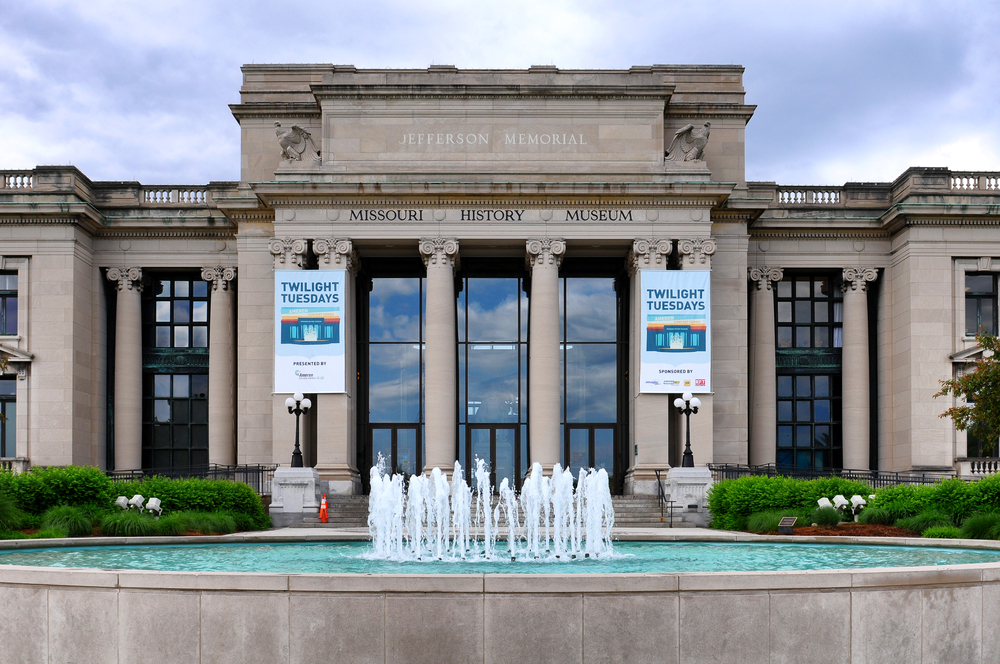 The columned front of the Missouri History Museum with a fountain in front.