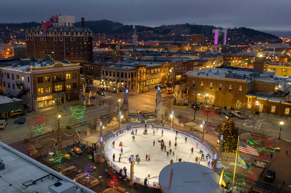 Aerial view of the ice skating rink in downtown Rapid City, showing one of the best things to do in the Midwest for Christmas.