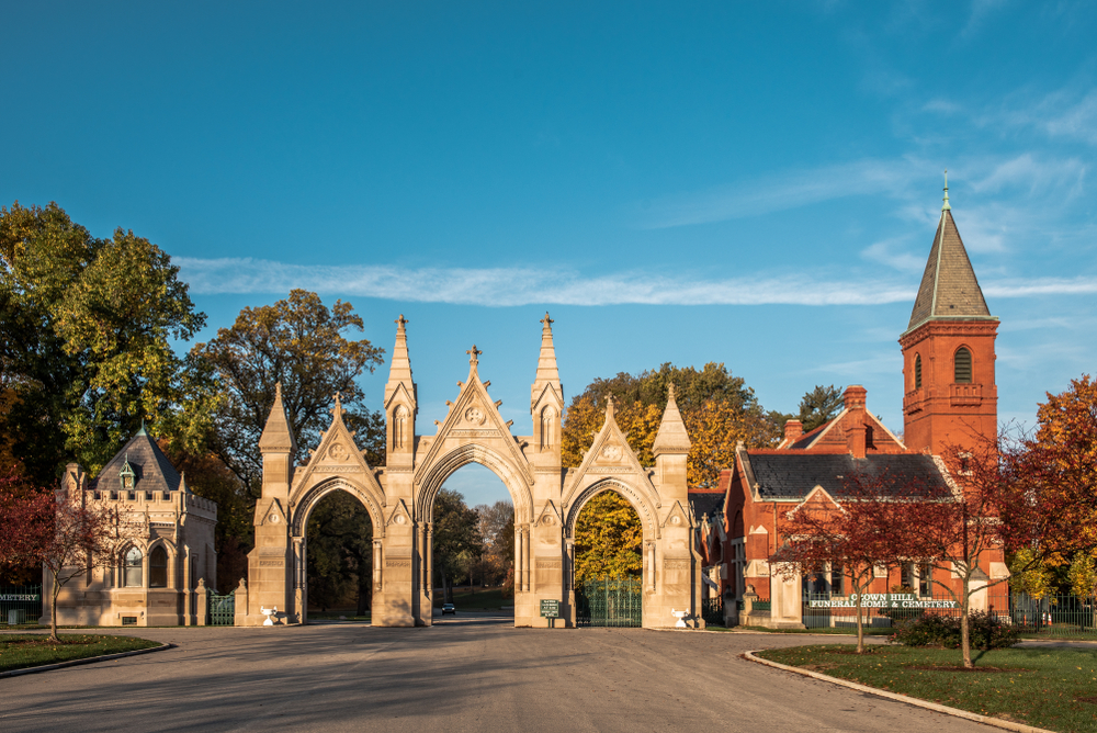 The entrance to the Crown Hill Cemetery bathed in golden light.