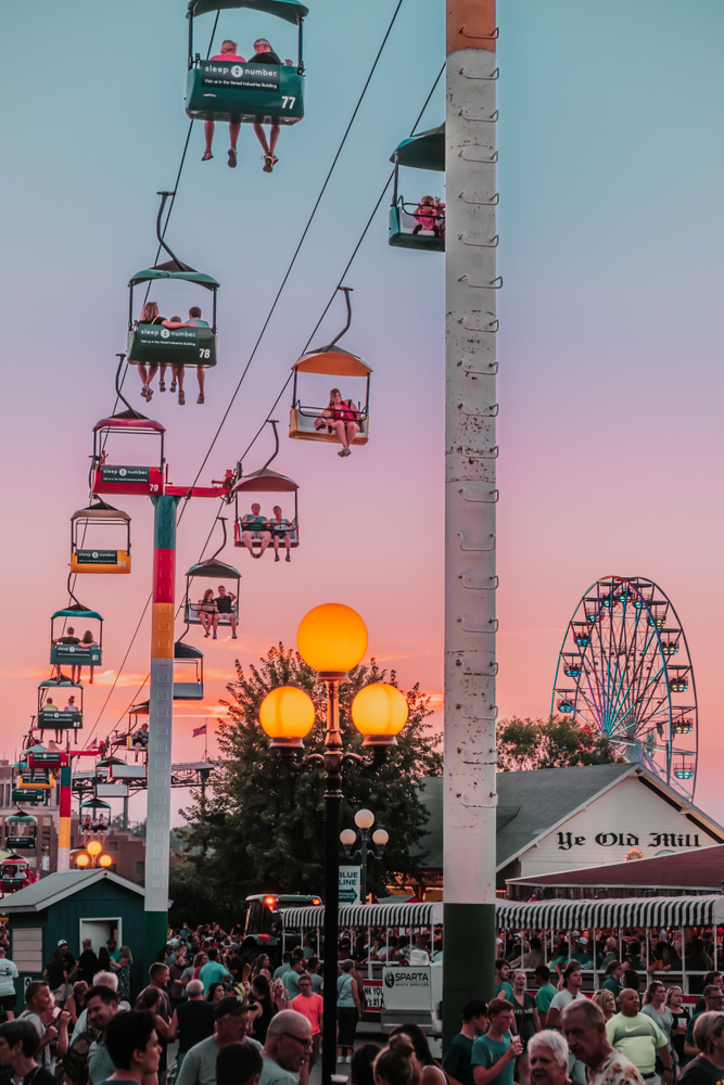Rides and crowds at sunset at the Iowa State Fair.