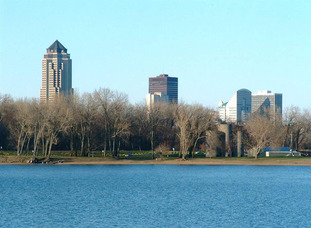 Gray's Lake with trees and skyscrapers on the other side.