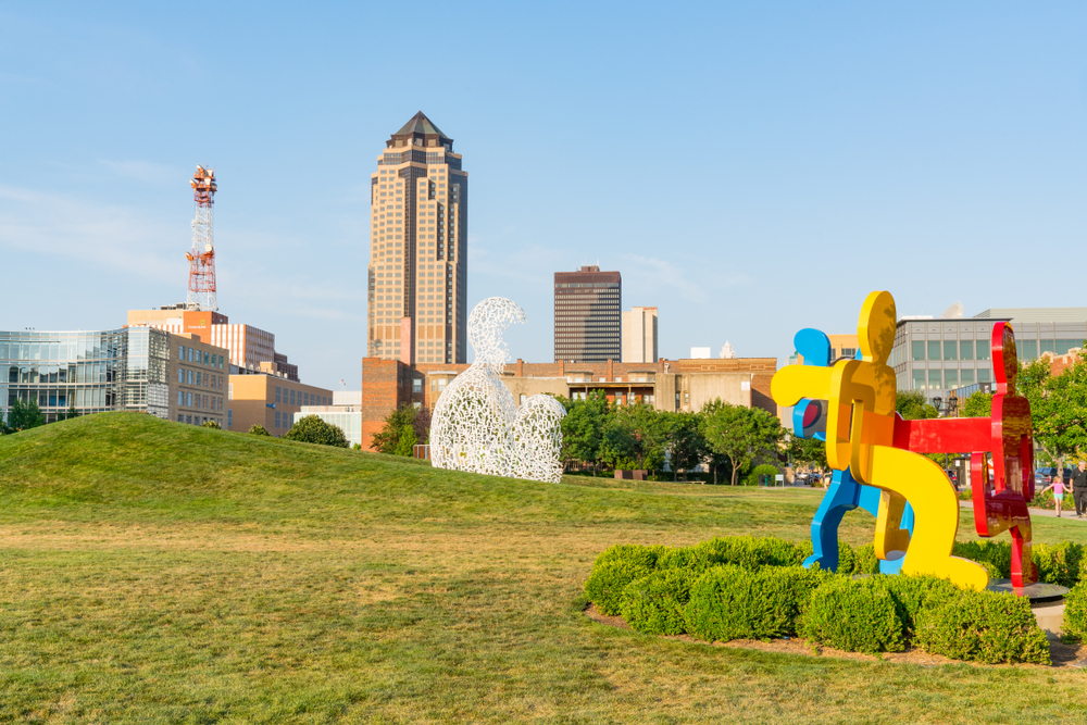 Big sculptures at Pappajohn Sculpture Park with the city in the background.