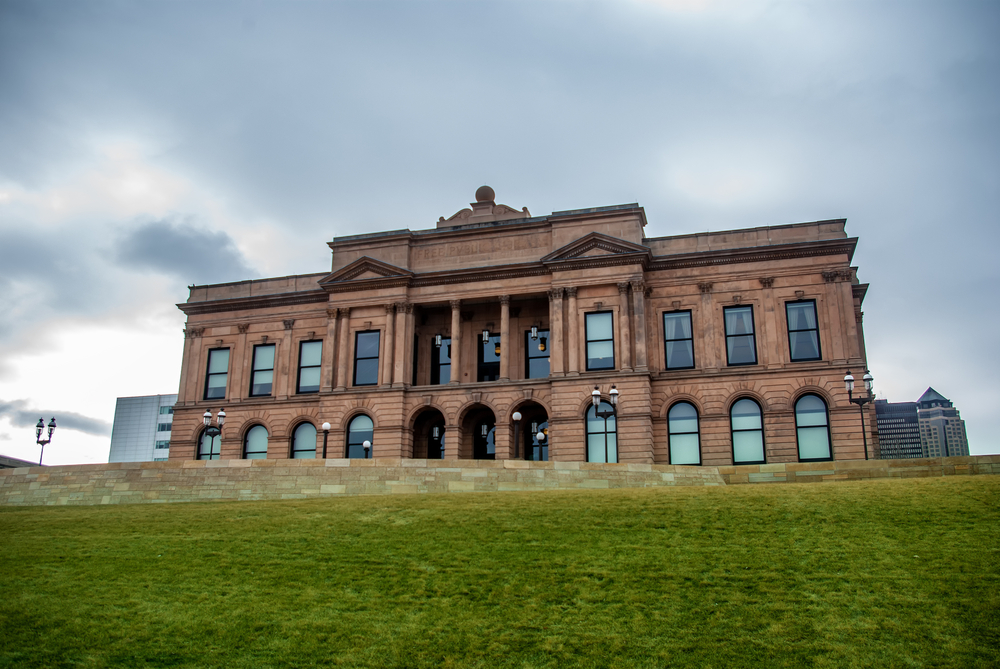 The World Food Prize Hall of Laureates looks imposing on a hill under a dark sky.