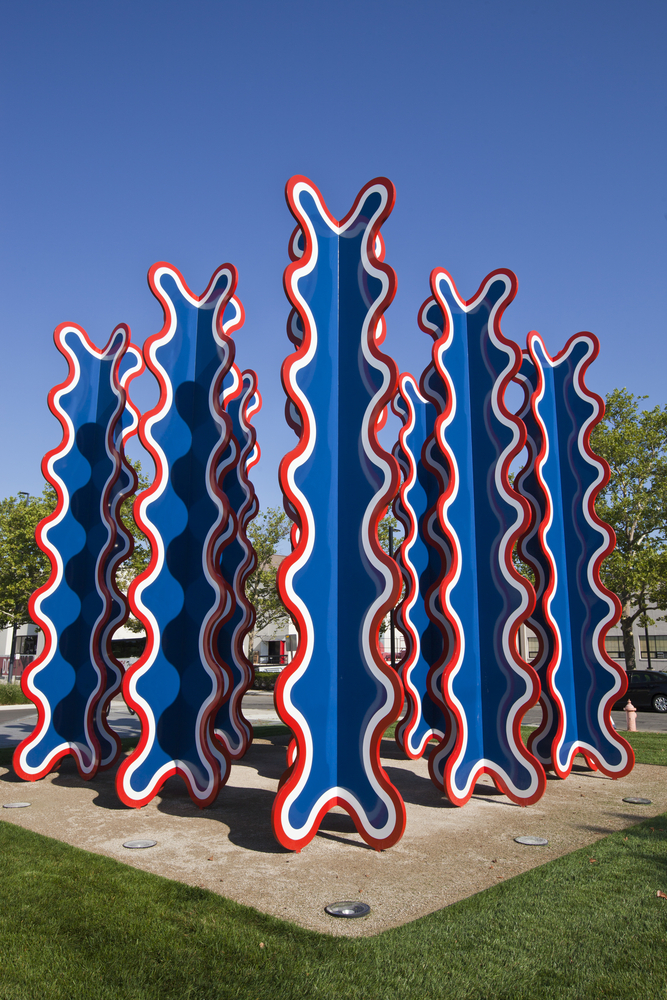 An abstract sculpture is depicted.  Tall wiggle turrets of red, white and blue stand tall in front of the Columbus Museum of Art, one of the most charming things to do in Columbus Ohio