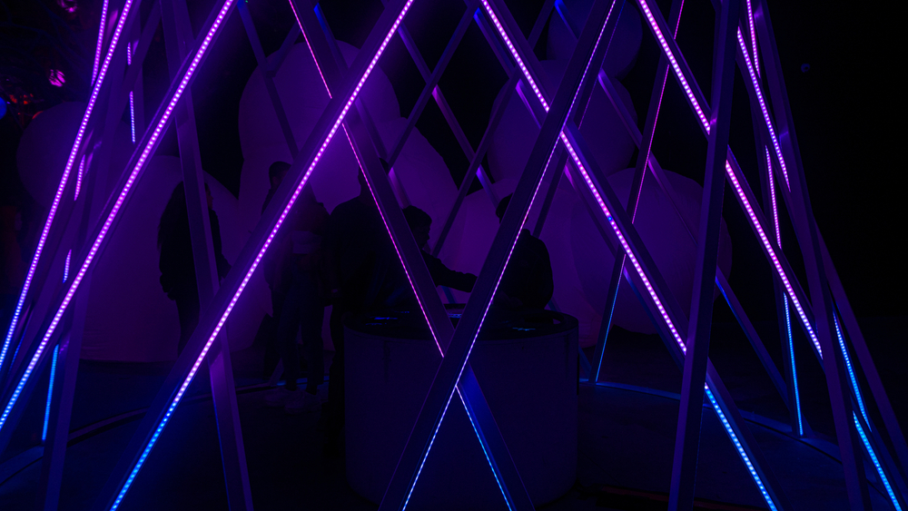 An abstract picture of one of the best things to do in Columbus Ohio, this picture of otherworld shows a swooping LED cage like structure illuminated in purple and blue in the dark.