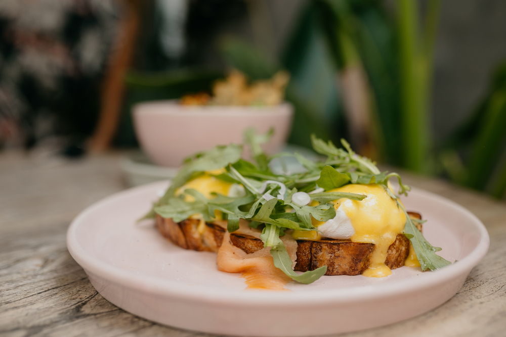 Two eggs on toast with hollandaise sauce over
