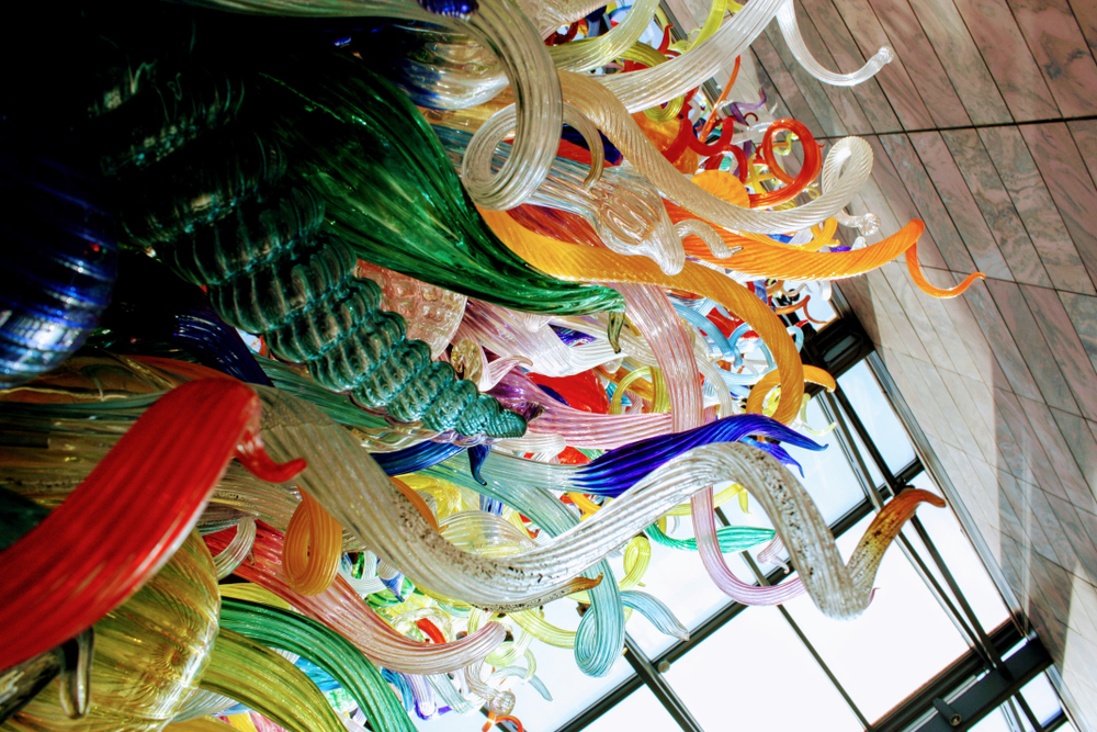A large multi colored glass sculpture in the Joslyn Art Museum, one of the best things to do in Omaha. The glass is all twisted in different shapes and is both speckled and solid colors.