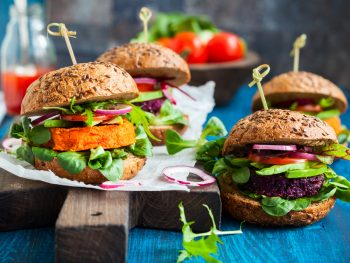 small veggie burgers on a chopping board
