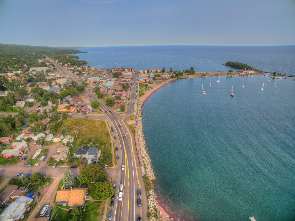 An aerial view of Grand Marais with roads, beach and sea visible.