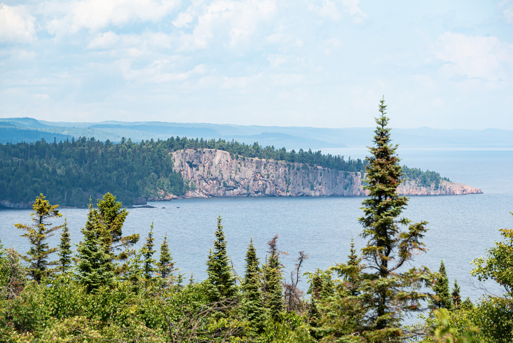 The shoreline of Lake Superior At Grand Marais. Trees in the foreground