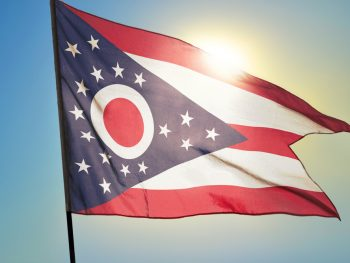 Ohio state flag, red and white stripes and blue triangle with white stars.