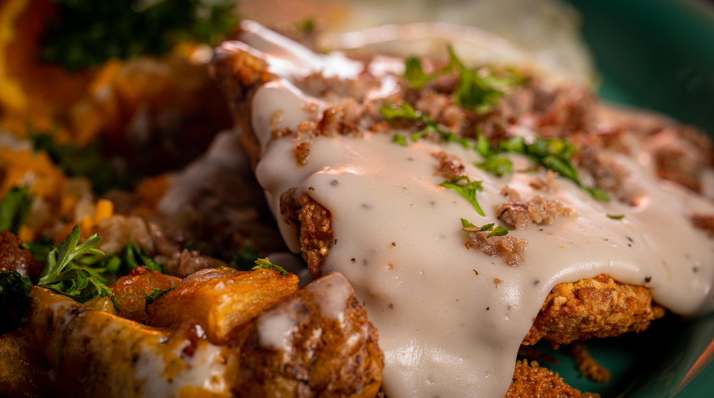 Chicken fried steaks with cheese sauce