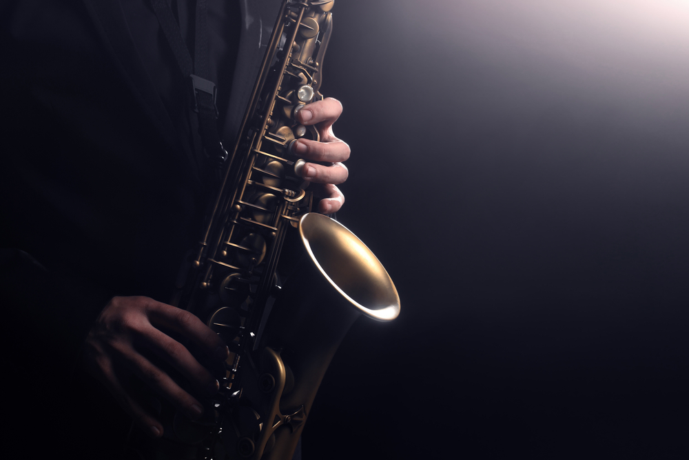 Close up of someone playing the saxophone.