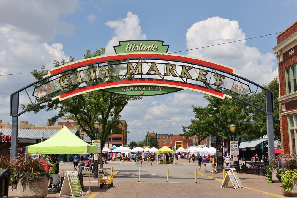 Entrance to the City Market in Kansas City with a vintage sign and booths in the background.