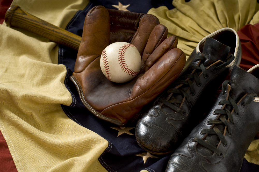 Collection of vintage baseball equipment.