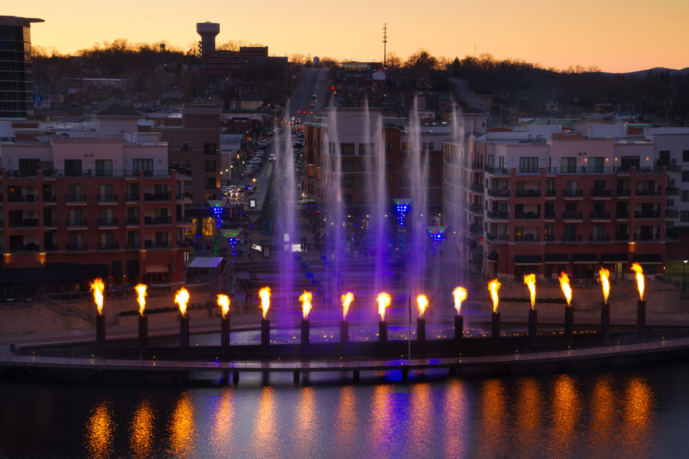 A skyline view of Branson with the fountain and fire show in the foreground one of the things to do in Branson MO
