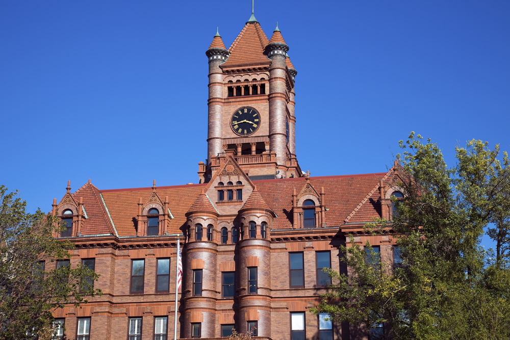 A beautiful, historic building in Wheaton, Illinois, with reddish exterior, turrets and large clock. Small Illinois town.