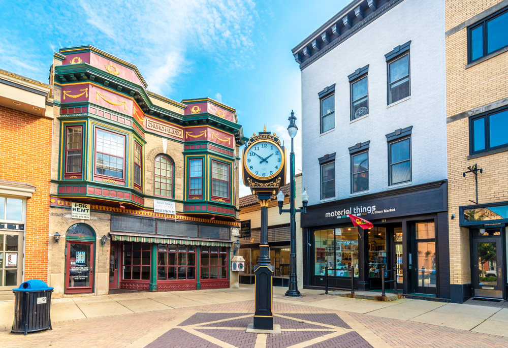 One of the cute small towns in Illinois with vintage buildings in background and clock in forefront