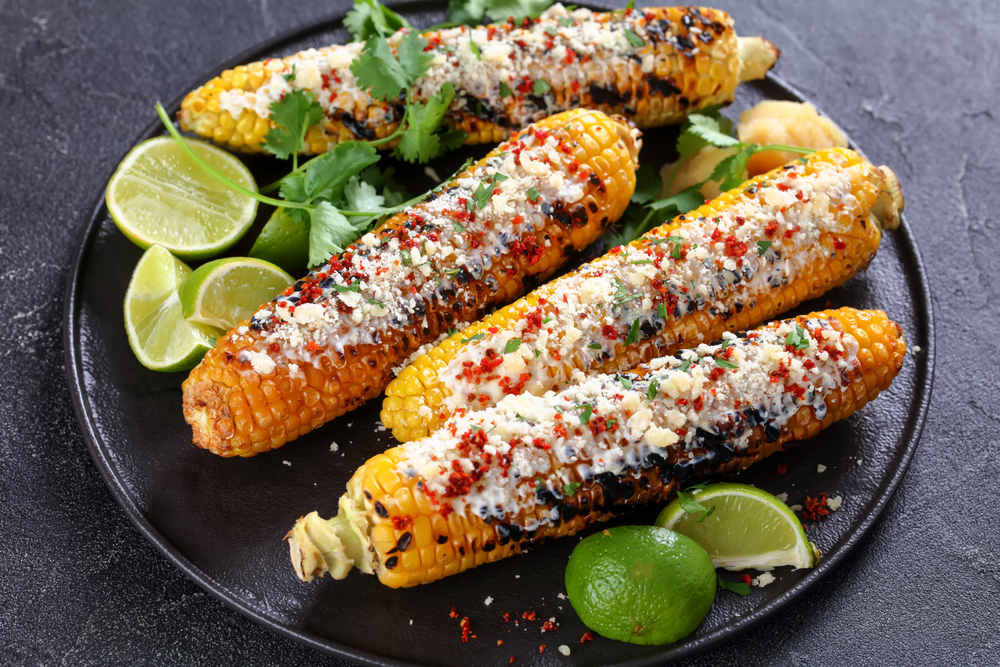Grilled corn with a sauce on a plate