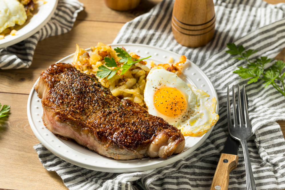 Steak and eggs and potatoes on a plate