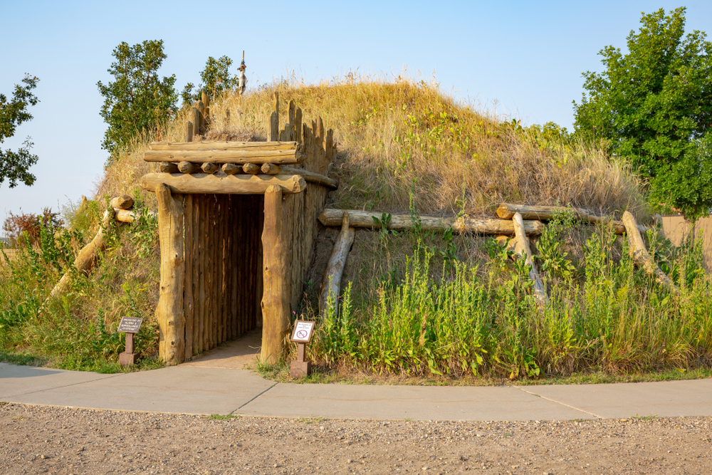 Old wood house covered with soil and grass things to do in north dakota