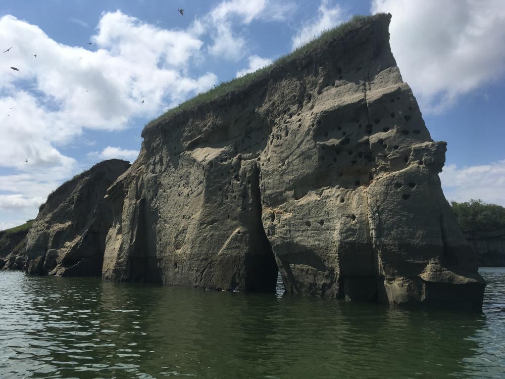 Large rocks in between a lake