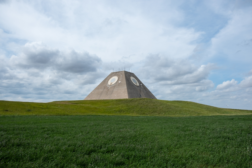 Pyramid structure in the middle of green ground